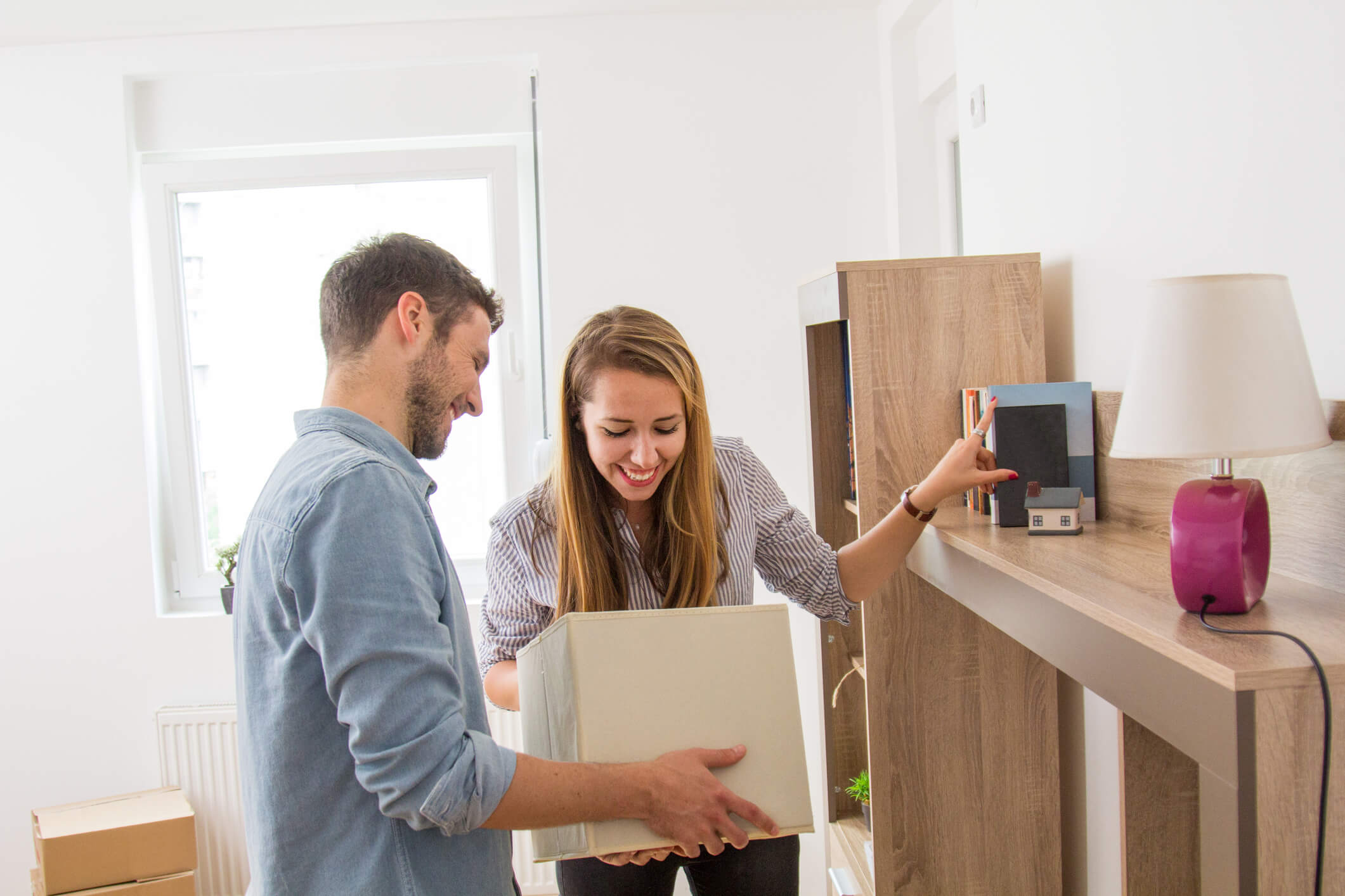 A couple organizing their apartment