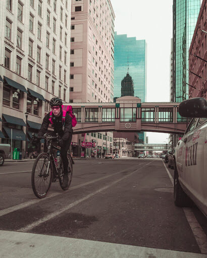 Man biking through downtown Minneapolis